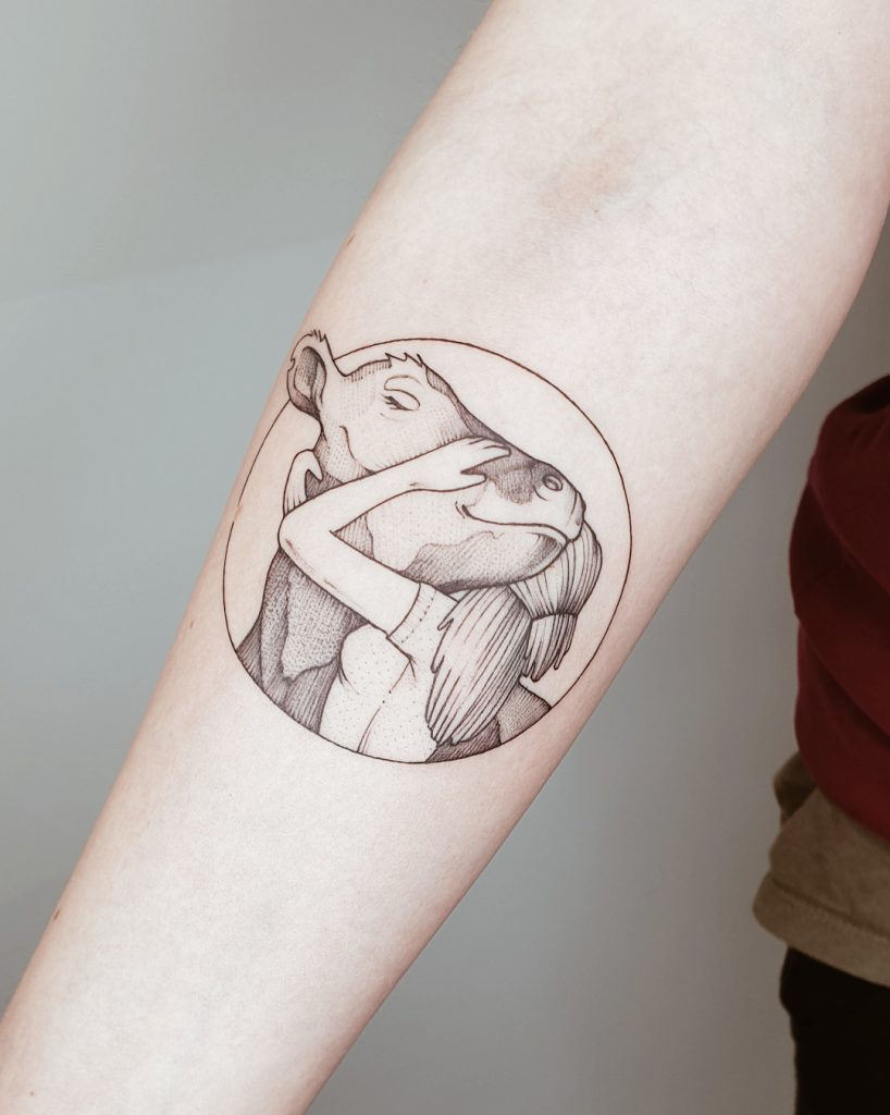 Kuh Tattoo am Unterarm